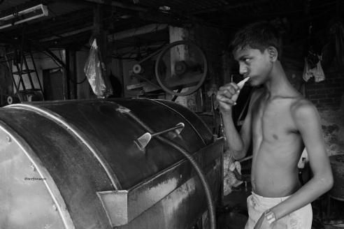 A young boy,son of a washerman starts his day at Dhobi Ghat