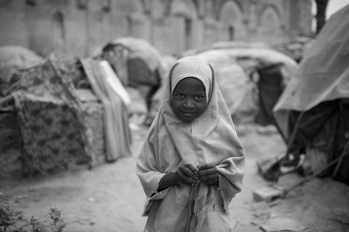 A young refugee on the grounds of the Cathedral of Mogadishu. The Cathedral of Mogadishu is located in the Hamar Weyne district, which is the oldest town in Mogadishu. The cathedral was built in 1928 by Italian colonists and destroyed by Islamic fundamentalists in 2008.