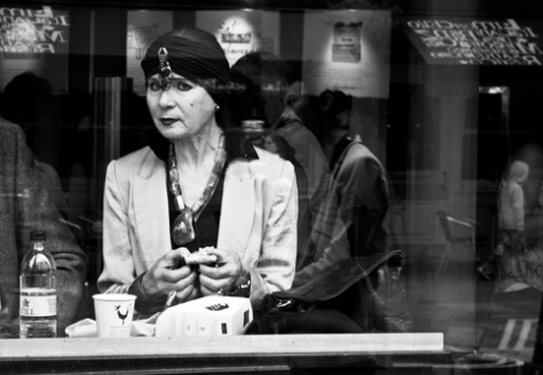 Cafe window woman London, England