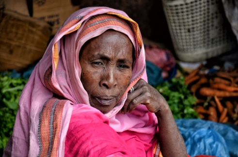 An elderly woman selling vegetables along the street in Harar, Ethiopia.