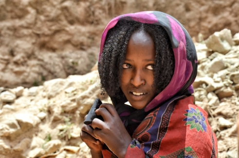 """Young Borana woman near a """"singing well"""". Southern Ethiopia."""