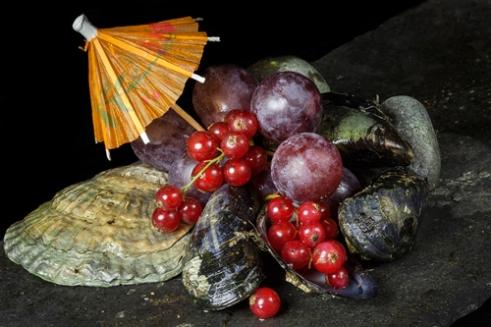 Garnish with a twist shellfish and fruit