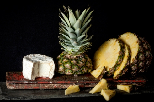 Garnish with a twist cheese and pineapple