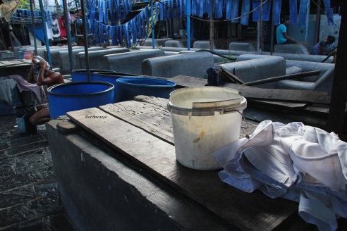 Morning at Dhobi Ghat, seen here are the open washing pits and bulk of jeans set to dry