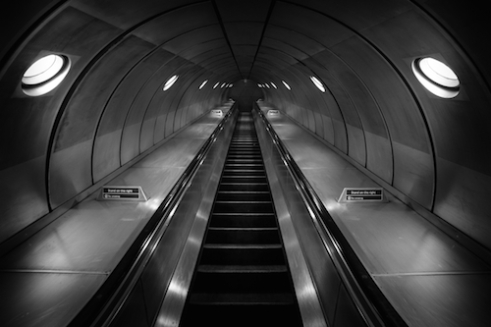 The Only Way is Up Its not often you can find an empty escalator in one of London's busy stations. The silver tunnels and the metallic steps give a fantastic chrome effect to black and white photographs.