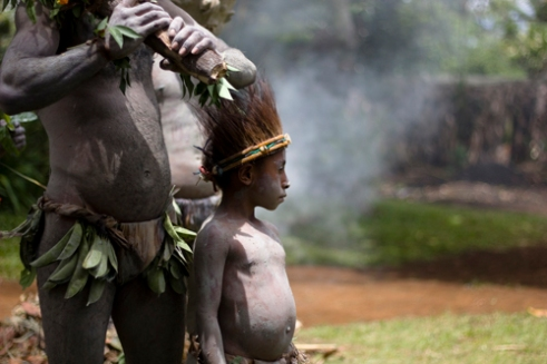 The young are indoctrinated into the ancient ways of the Asaro Mudmen from an early age and take part in the tribal rituals that symbolize warriors in battle. Asaro Mudmen Tribe - Goroka, Central HIghlands, PNG