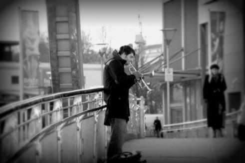 Busker on the bridge Bristol, UK