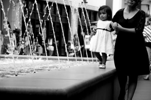 Child, mother and fountain Irvine, California, USA