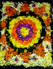Colorful flowers arranged in pookalam