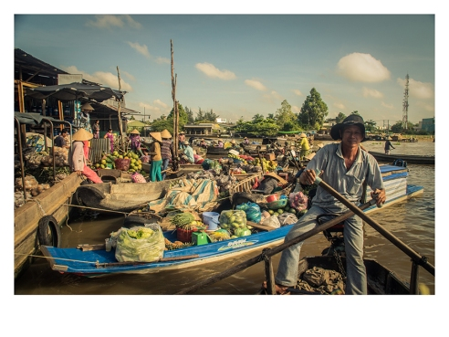 Floating market in the Mekong River, Vietnam