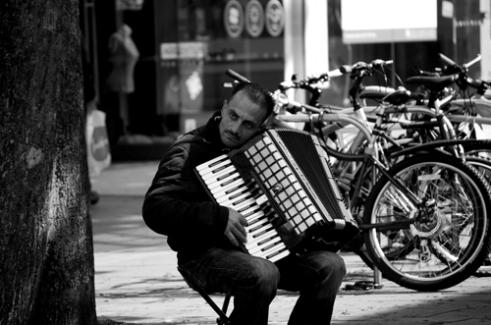 Sad eyes of accordion player Bristol,UK