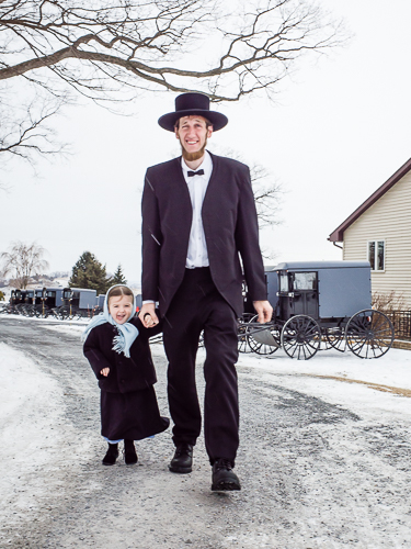 Amish Father Walks with His Daughter