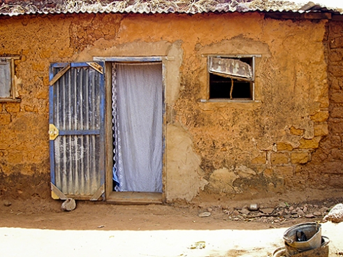 A backyard in a town in Burkina Faso lets your fantasy roll on for a moment. Is there anybody inside?