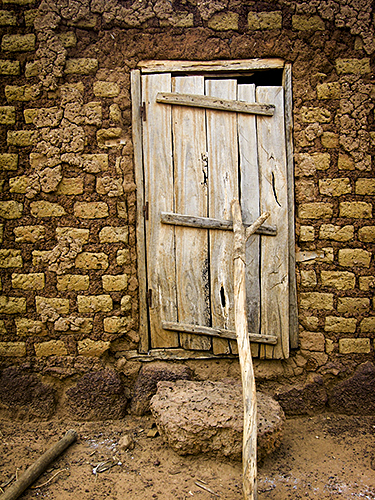 The small village near Sikasso in Mali, West Africa. Every small house has their own head Door with decorations.