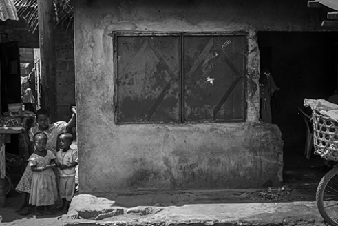 Children looking out on the market place. From Dar-Es-Salaam, Tanzania.