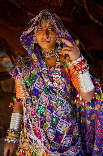 This Mir woman was recently married. She will wear the ornaments at all times as there is nowhere else for safekeeping. Jewellery will serve as a bank account – buy or sell as required because there is no guarantee of family income.