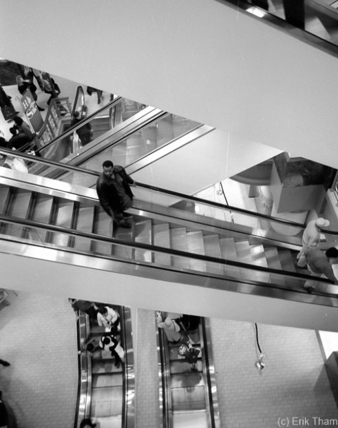 Chicago, IL: A lonely man on an escalator at Marshall Field's department store on Michigan Ave.