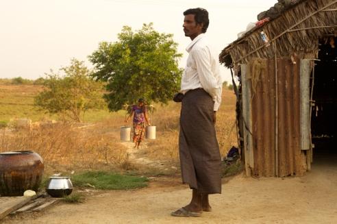 Kyaw Win overlooking farm