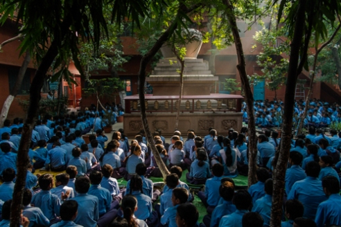 Sarnath, Uttar Pradesh, India. Every morning students gather in a general assembly in the central courtyard of the school for collective prayers and songs. The school of Sarnath in India is the first intercultural and interreligious school of Alice Project, founded in 1994 on the site of the Buddha's first sermon after his enlightenment. There are other two Alice schools in India: at Bodh Gaya in Bihar and at Bodhisatta Deban village in Arunachal Pradesh.