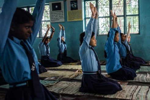"Sarnath, Uttar Pradesh, India. The gym room is used exclusively for Yoga lesson. This practice of ""body education"" is part of the exercises on attention, perception and self-analysis that over the years have shown an increase in concentration and learning of the students."