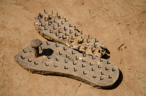 Traditional footwear made out of wood and iron is worn while performing religious ceremonies where plants are worshiped. Baiga Tribe Village outside Kanha National Forest in Madhya Pradesh, India.