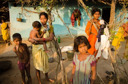 A family portrait of members of the Baiga Tribe. Baiga Tribe Village outside Kanha National Forest in Madhya Pradesh, India.