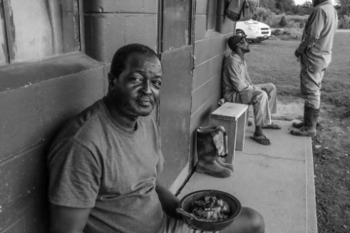 Jamaican farm workers enjoying a break from the harvest in Upstate NY at their harvest party.