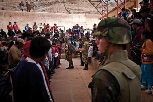 "The bonus ""Juancito Pinto"" is delivered in rural areas, far from urban centers, by the Bolivian Military Police. They deliver 200 bolivianos to each student who went to school all year round, regardless of the results."
