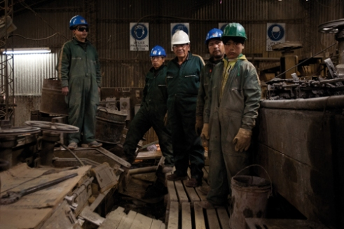 A group of young miners pose with the chief engineer of the Mining Cooperative of Colquechaca, Bolivia.