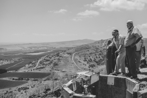 Golan Vista June 10, 2015 - Palestinian men look toward the boarder of Syria from an Israeli bunker at Golan Heights.
