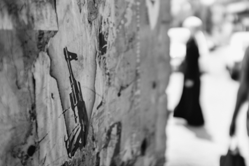 Decaying Gun Image Nablus June 11, 2015 - A image of a gun remains from a decaying poster in a Nablus alleyway.