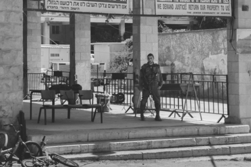 Soldier Hebron June 16, 2015 - An Israeli soldier stands guard in the Israeli controlled H2 section of Hebron.