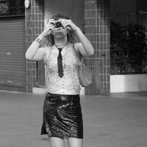 Transsexual man doing a photo on Paral·lel Avenue in Barcelona.