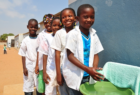 Escola Primeria 8061, located in Kikola, Angola, 2010. Students participate in a handwashing program meant to improve hygiene, promoted by UNICEF.