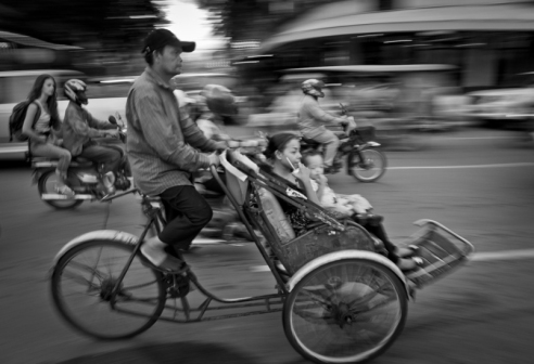 Rickshaw in traffic Cambodia