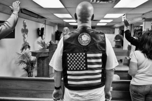 Biker with Am Flag vest. Peacemakers International church - Chene St., Detroit