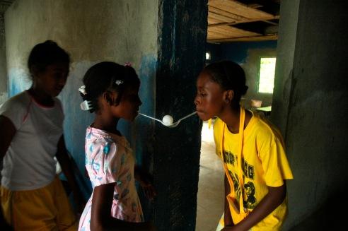 Girls playing school activity, Bahia Solano,Choco, Colombia