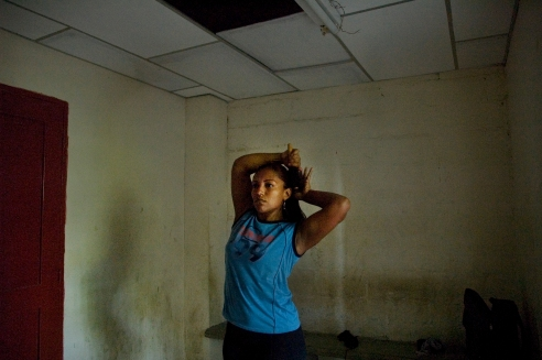 Female boxer after training routine, in spite of the lack of support for female boxing in Colombia,