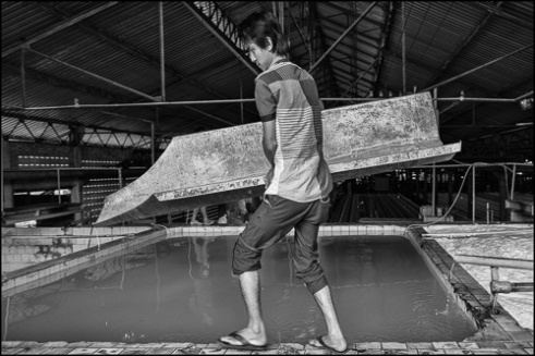 Worker at the Chup Rubber Factory, Kompong Cham Province, Cambodia