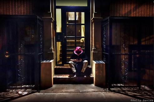 Man Texting on Stoop. East Village, NYC