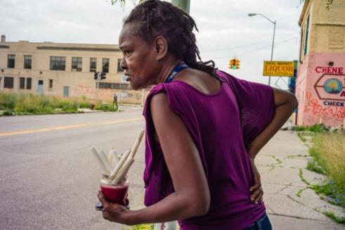 Rose standing on Chene Street. Peacemakers International church - Chene St., Detroit