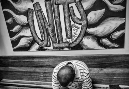 A painting and member during service. Peacemakers International church - Chene St., Detroit.