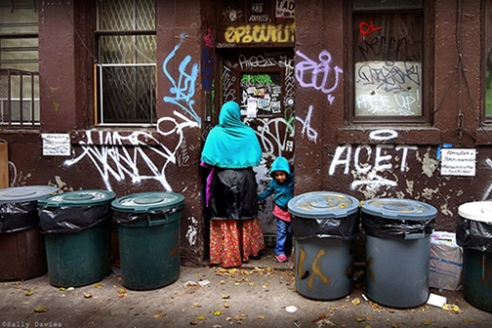 Mother and Son at Doorway. East 4th Street, East Village, NYC
