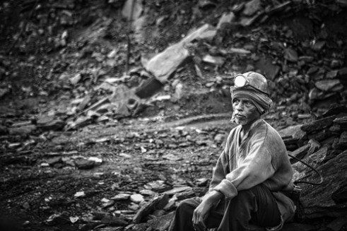 "_""Miner"" rest after many hours to dig coal underground."