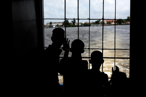 Some children are heading by boat to Regla near La Havana