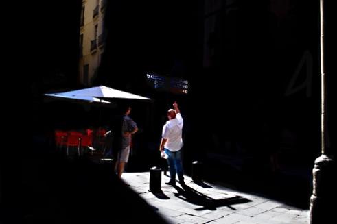 Tourists seeking streets directions in El Born. Barcelona, Spain