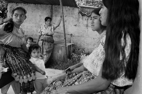 Patients from distant villages around Lake Atitlán waiting to be seen by a healer in San Pedro. Even though the practice of healing is common throughout Guatemala, the healers and bonesetters of San Pedro are particularly renowned.