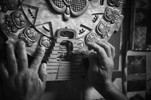 Shaman Samuel with the sacred Maya calendar of fiestas and rituals used in Maya ceremonies. The elaborate computation of the calendar requires the expert knowledge of the Daykeepers. San Juan La Laguna, Guatemala