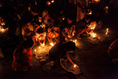 The night time ceremony of 'Misa Arwah'. During the ceremony held once a year to commemorate those who died whaling locals light candles and place them all over the beach.