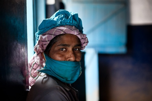 Valsala, who works in the factory wears a protective mask to prevent inhalation of tea dust from the CTC (Cut Tear & curl) process. The estate provides all its factory workers with appropriate protective clothing as part of their comprehensive health and welfare scheme.